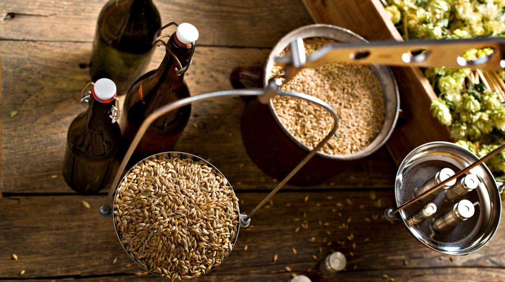 Featured   Top view of a man weighs malt for home brewing of beer   Home Brewing: Fun Hobby Or Vital Skill?