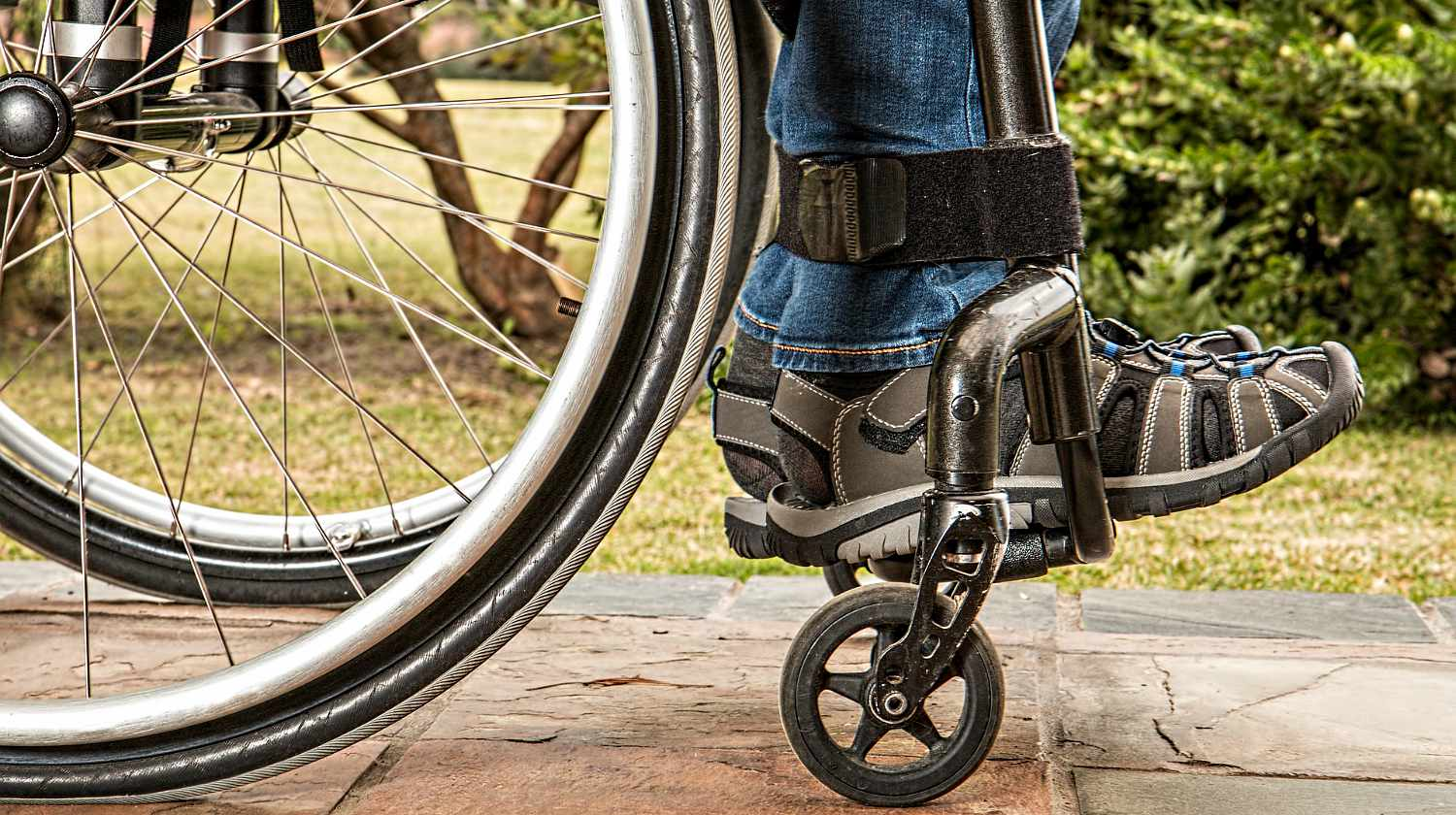Feature | Handicapped man sitting in a wheelchair | Prepping Tips For The Mobility Challenged