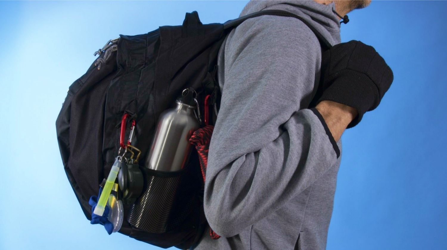 Feature   Man with bug out bag on blue background   How To Argue With Non-Preppers
