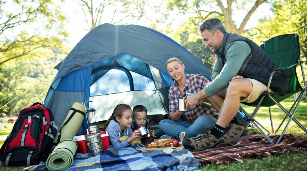 Feature | Family having snacks and coffee outside the tent at campsite | Camping Snacks | Appetizing Recipes Perfect Outdoors