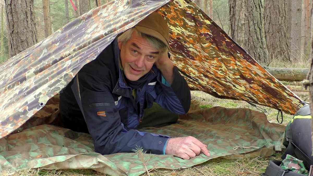 Happy man inside tent | The Survival Rule of Threes