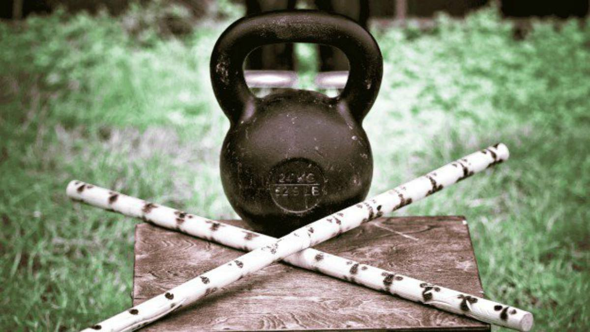 Kettlebell and two sticks | Why The Kettlebell Is The Ultimate Tool For Physical Preparedness