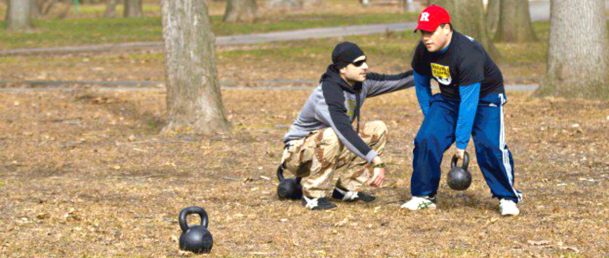 Man practice kettlebell with his trainer | Why The Kettlebell Is The Ultimate Tool For Physical Preparedness