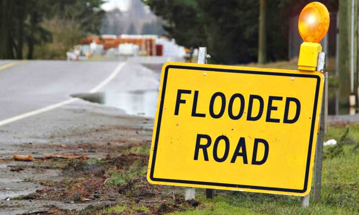 Yellow sign that the road is flooded | Flood Survival Tips | How To Survive Before, During, And After A Flood