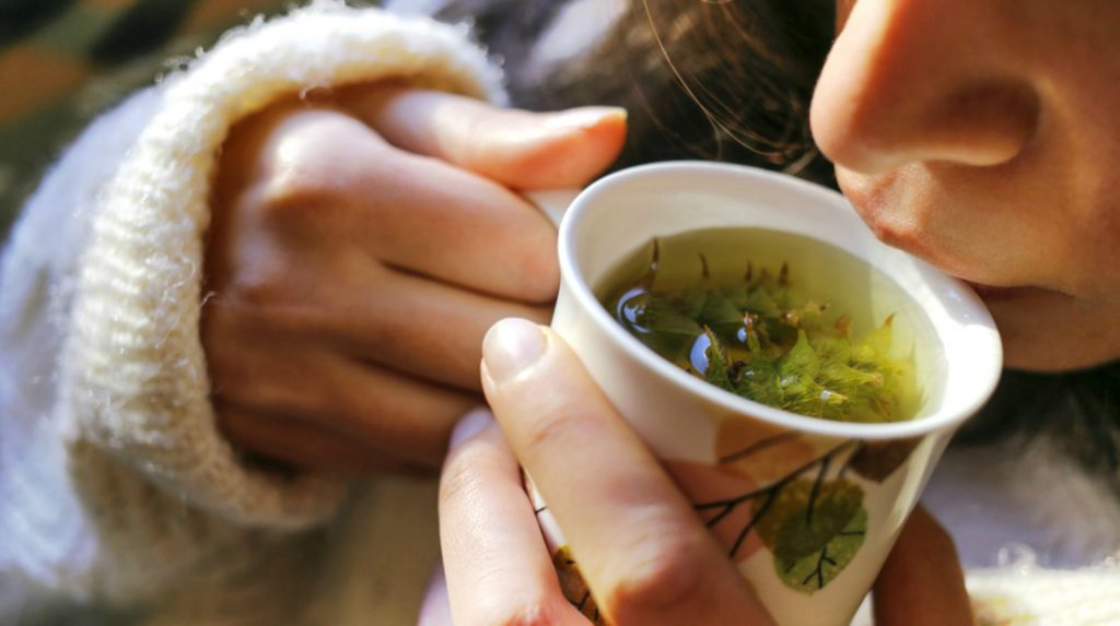 Woman drinking tea   Home Remedies For Cold And Flu   Surprisingly Simple Natural Relief