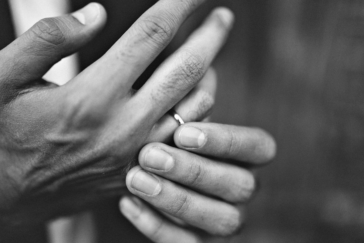 Black and white photo of hands wearing ring | Ring Stuck On Finger? This Trick Could Save Your Finger And Your Ring