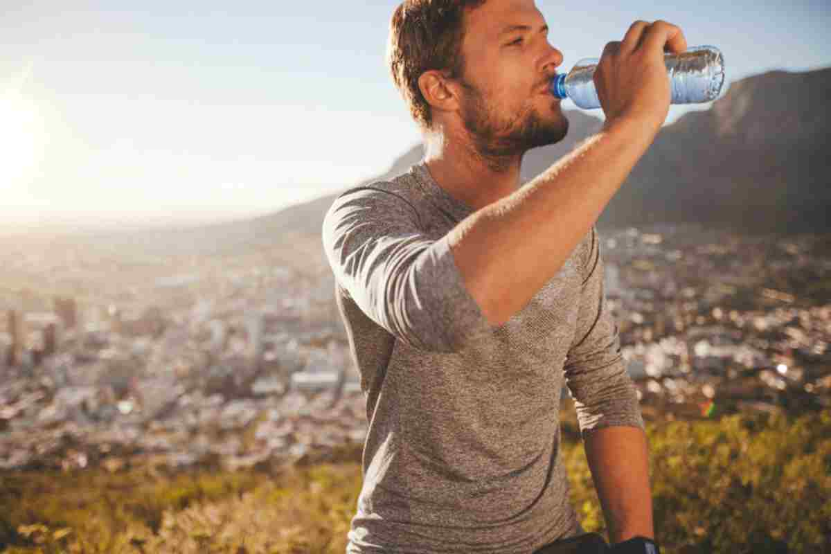 Man Drinking Water | Conquering The Cornerstones: Water - The 2nd Pillar Of Survival